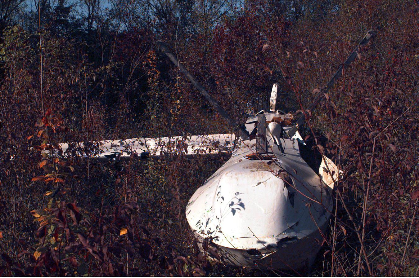 A Close Up Front View Of The Fuselage Section From Wreckage Predator Unmanned Aerial Vehicle UAV Laying On Hillside In Russian Sector