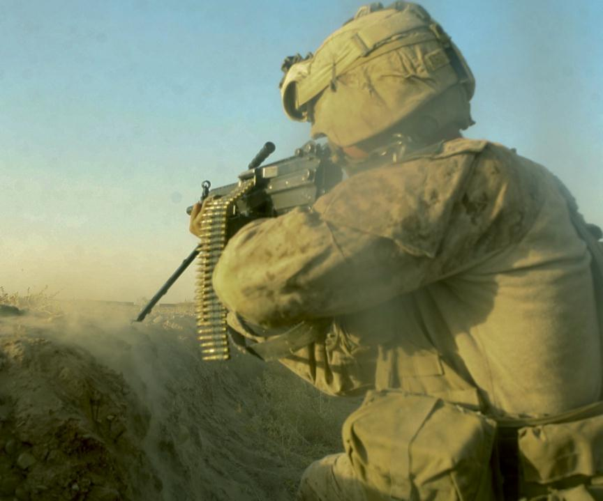 us marine corps lance cpl roy aeschlimann with bravo company 1st battalion 5th marine regiment returns fire during a firefight in the nawa district