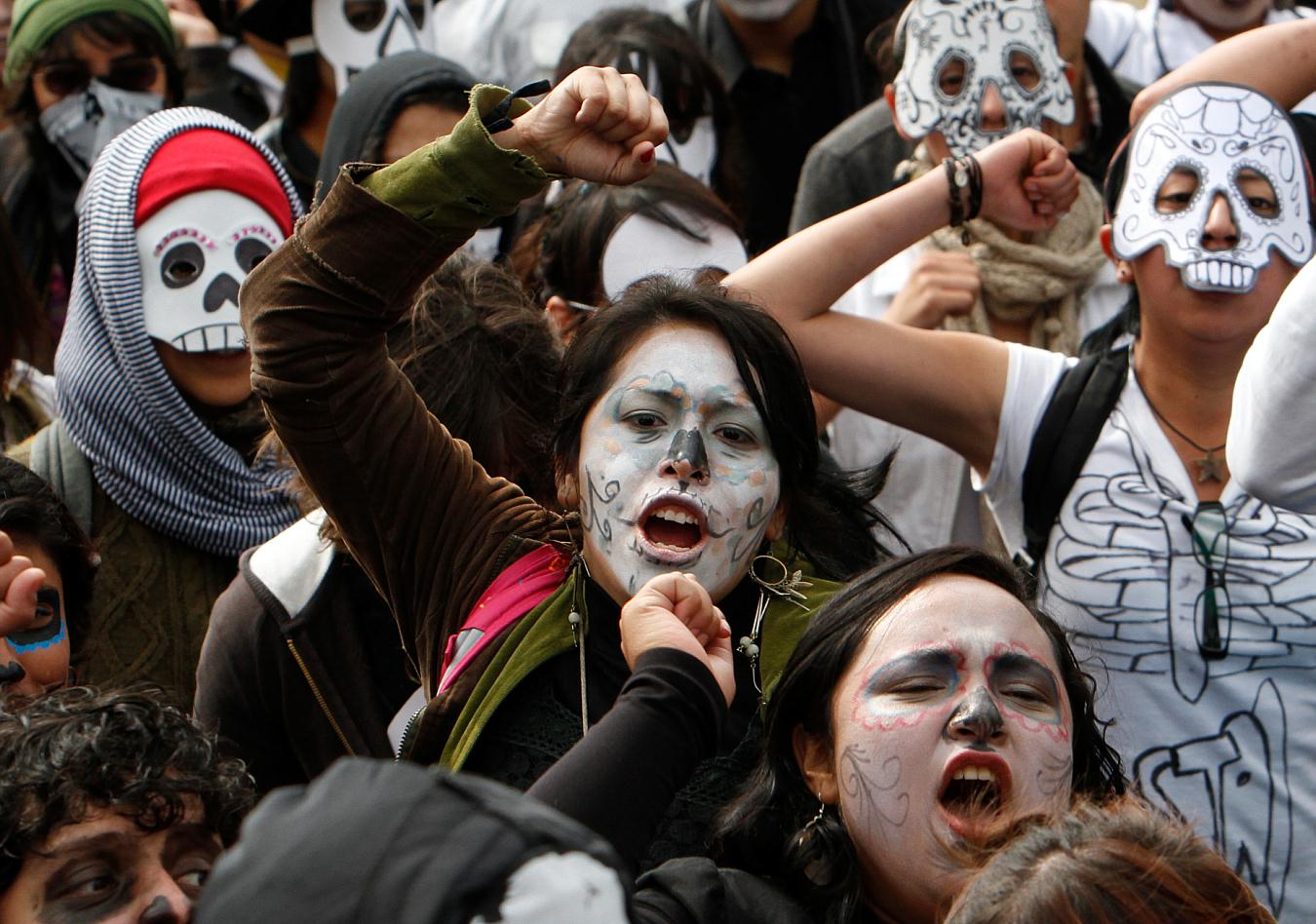 Demonstrators wore skull masks